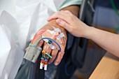 Nurse comforting hospital patient