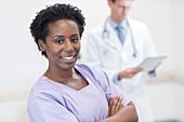 Woman nurse smiling towards camera