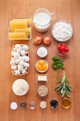 Ingredients for cannelloni au gratin with mushrooms and ricotta