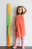 5-year-old girl measuring herself