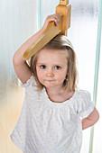 3-year-old girl measuring herself