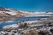 Road bridge over a reservoir in winter, USA