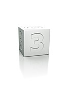 Cube with the number 3 embossed.