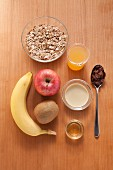 Ingredients for making a cereal and fruit dish with almond milk