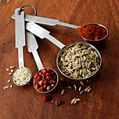 Spices and sesame seeds in measuring spoons