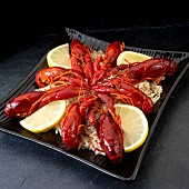 Cooked crayfish with lemons on wild rice
