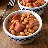 Frankfurters with baked beans in two serving bowls