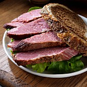 Corned beef sandwich on marble rye with lettuce