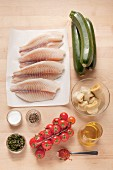Ingredients for steamed tilapia fillet with Mediterranean vegetables