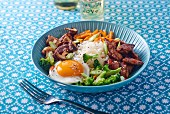 Bibimbap (a Korean rice dish with beef, vegetables, egg and gochujang)