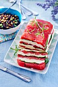 Tomato terrine with mozzarella and basil