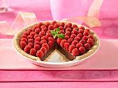 Chocolate ganache pie topped with raspberries
