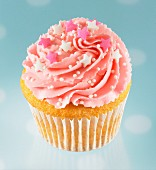 Cupcake with pink icing and sugar decorations