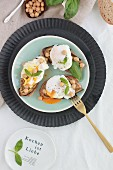 Tartines with poached egg, chickpeas and basil