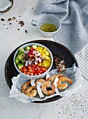 Rainbow Caribbean salad with prawn and coconut skewers