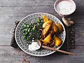 Indian potatoes with ginger spinach and chilli yoghurt (Sirtfood)