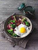 Vegetarian buckwheat bowl with broccoli and fried egg (Sirtfood)