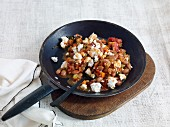 Bean chilli with feta served in a pan