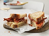 Sandwich with cheese and crispy bacon, cut into two parts