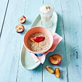 Muesli with plums and a chai latte
