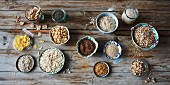 Various muesli ingredients in small bowls
