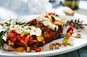 Grilled bread topped with mediterranean vegetables and feta