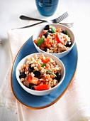 Spelt salad with canned tuna in olive oil, tomatoes, black olives and mint