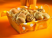 Bread rolls with caraway seeds and sunflower seeds in a bread basket