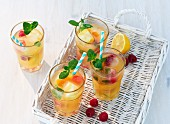 Fruity iced tea with mint on a white basket tray