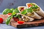 Pita bread sandwiches with grilled vegetables paprika, eggplant, tomato, basil and feta cheese