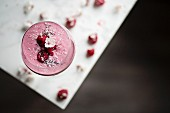Raspberry smoothie on white table