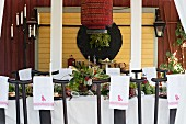 Monogrammed napkins on backrests of chairs at festively set table