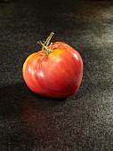 One tomato (variety: Coeur de Boeuf)
