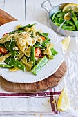 A pasta salad with green beans and lemon vinaigrette