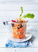 Carrot and cranberry salad in a glass