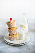 Almond muffins with cocktail cherries and milk