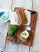 Homemade spice bread with butter and cress