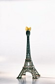 The Eiffel Tower with a farfalle bow on the top to symbolise France and Italy