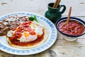 Huevos Rancheros (fried eggs on a corn tortilla with roasted beans and tomato sauce, Mexico)