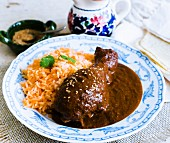 A chicken leg with mole poblano and rice (Mexico)
