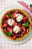 A berry tart with vanilla ice cream