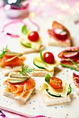 Various canapes with smoked salmon, cheese and salami for Christmas