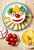 Dip mit Clown-Gesicht für die Kinderparty