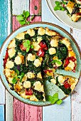 Frittata with garden vegetables, sliced