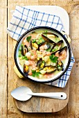 Shrimp chowder with mussels, corn and peas