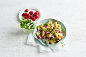 Apricot and raspberry gnocchi with pistachios