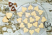 Heart-shaped Christmas cookies on baking grid