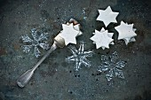 Ice crystal made of glass and cinnamon stars on metal