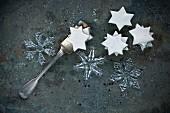 Ice crystal made of glass and cinnamon stars on metal