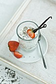 Chia pudding with fresh strawberries and vanilla bean in glass